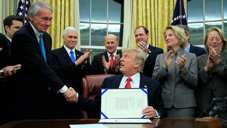 President makes comments while signing bill that gives Border Patrol new drug interdiction tools.