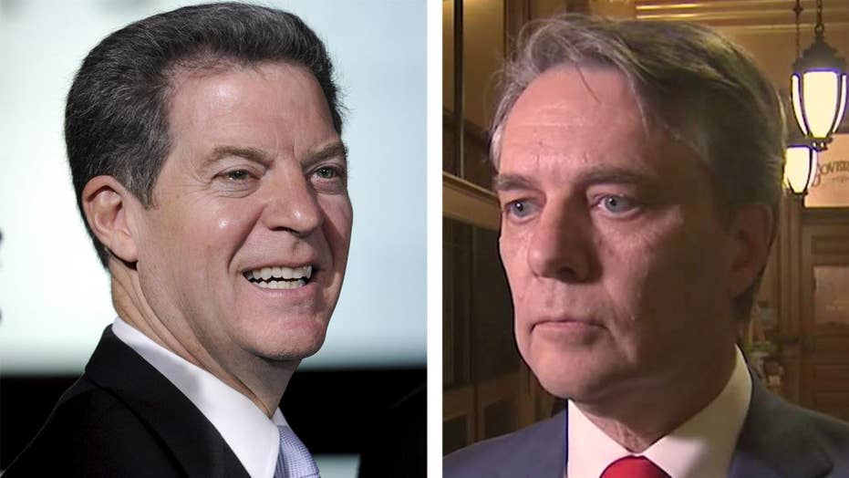 Kansas finds itself between two governors
