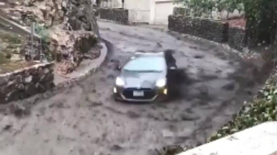 Burbank California residents are grateful they are unscathed after a wave of mud picked up their Prius, lifting it off the ground.