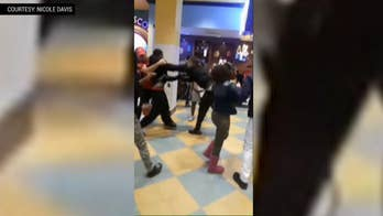 Violence erupted inside of the NewPark Mall in California when at least 20 pizza-parlor patrons duked it out over a missing cell phone.