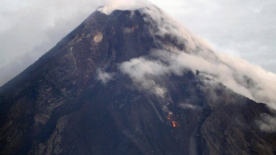 Philippines Mayon volcano spews lava, causes mass evacuations