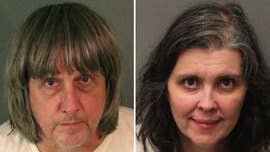 A Southern California couple is in custody on suspicion of torture and child endangerment after 12 of their children allegedly were found captive in the couple's home, with some of them shackled to beds.
