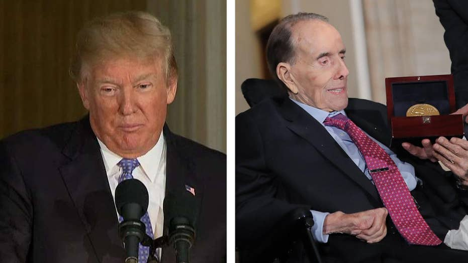 Trump signs legislation promoting Bob Dole to colonel for WWII ...