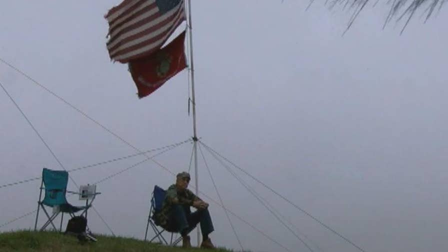 Mike Goble placed the flags in honor of two high school classmates who didn't return from Vietnam.