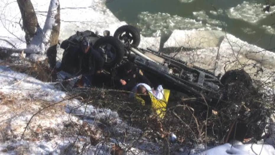 66-year-old man rescued after truck flipped into river