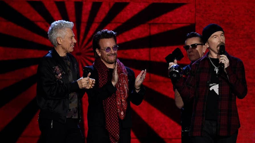 U2's new video for 'Get Out of Your Own Way' gained mixed reactions, due to politically charged imagery featuring President Trump and the Ku Klux Klan marching outside the White House.
