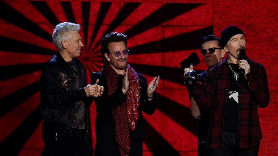 U2 releases music video with KKK marching on the White House