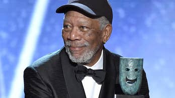 80-year-old Morgan Freeman accepts the Lifetime Achievement Award from Rita Moreno at the 24th annual Screen Actors Guild Awards at the Shrine Auditorium in Los Angeles.