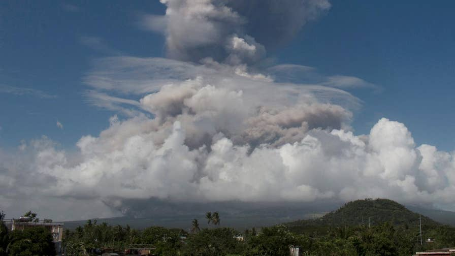Mount Mayon, the Philippines' most-active volcano, sent a huge plume of gray ash, steam and lava fragments into the sky and prompted officials to warn a major eruption may be imminent.
