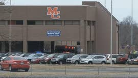 At least one person was killed and several others were injured when a shooter opened fire at Marshall County High School in Benton, Ky., officials said.