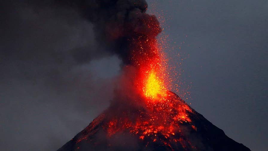 Mount Mayon shoots massive plumes of ash, lava into the sky forcing thousands of villagers to evacuate; officials set the danger zone at a 5-mile radius from the crater.