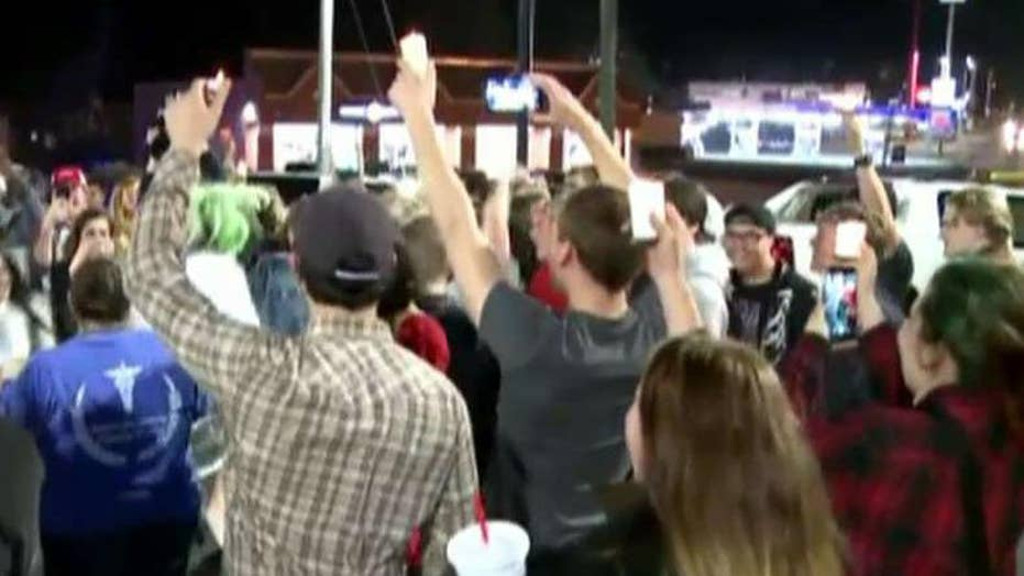 Locals hold candlelight vigil for burned down Taco Bell