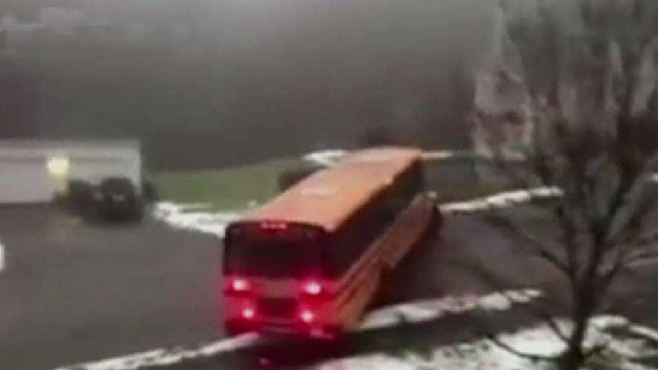 School bus slides backwards down icy street in Massachusetts