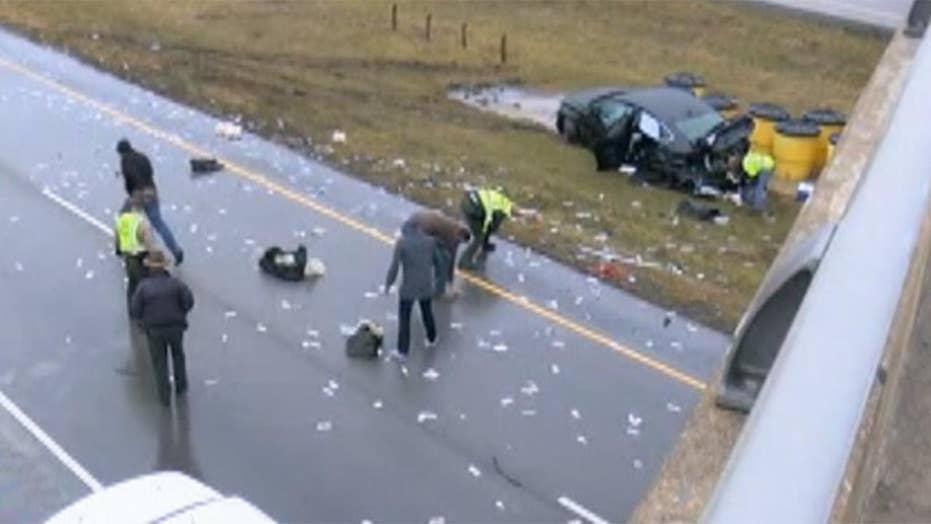 Cash scattered all over Illinois highway after crash