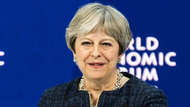 Theresa May urges tech giants to stop extremist content