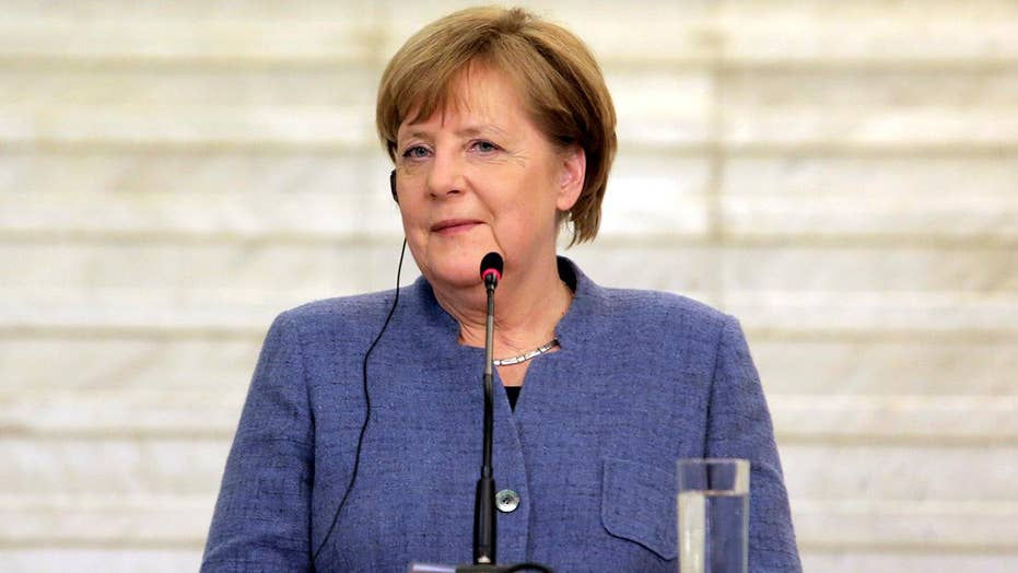 Merkel slams US isolationist polices at World Economic Forum