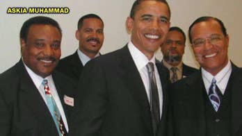 Journalist who took pic of then-Illinois Sen. Barack Obama and Nation of Islam leader Louis Farrakhan in 2005 at a Congressional Black Caucus meeting says he didn't make it public because he believes it would have impacted Obama's political future.