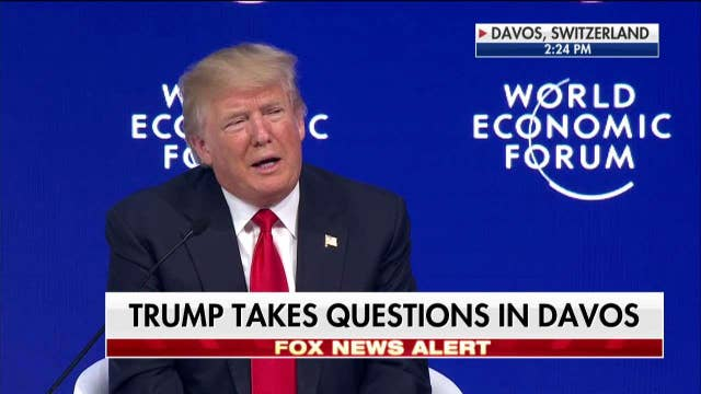Trump takes questions at Davos forum.