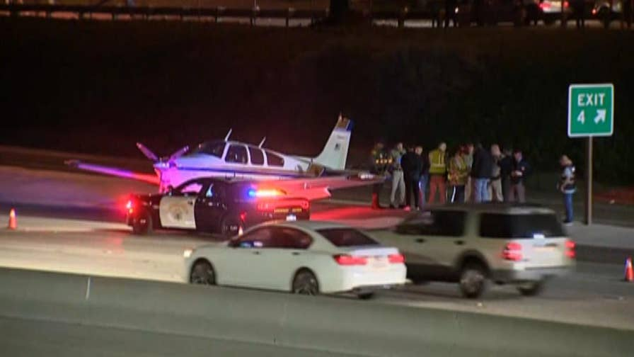 A small plane headed for Van Nuys, California, made an emergency landing on a freeway in Costa Mesa after experiencing engine trouble.