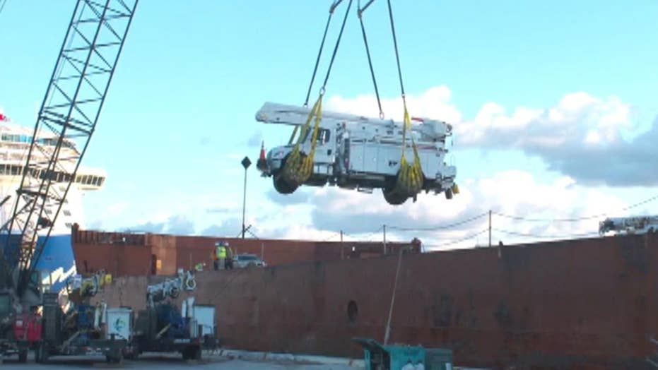 More utility crews arrive in Puerto Rico to restore power