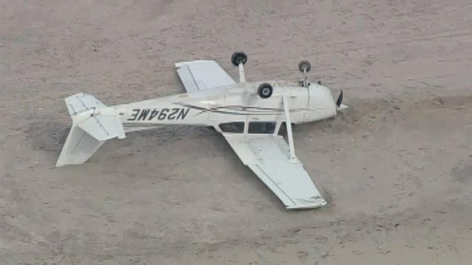 Plane flips after emergency landing on New York beach