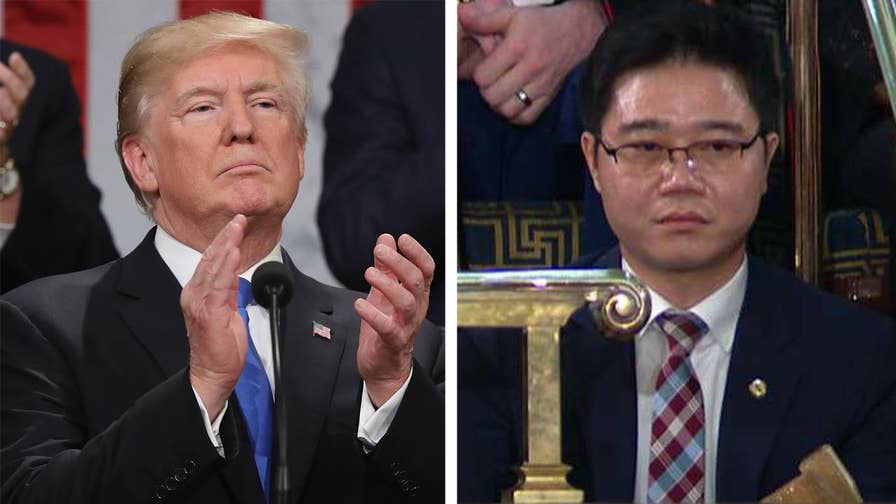 Ji Seong-ho holds up his crutches as symbol of defiance to the North Korea regime after President Trump details his harrowing journey to freedom.