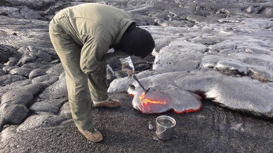 Scientists collect lava samples from live volcanoes