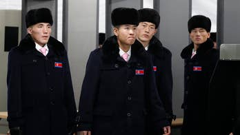 Raw video: North Korean winter Olympic team members, officials arrive in Gangneung.