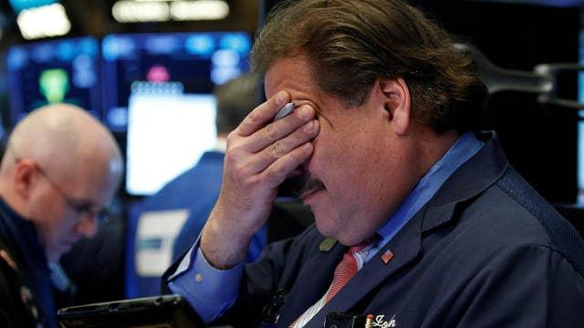 Stocks slide sharply, erasing gains made over last month