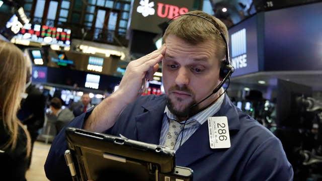 Wild market swings following Monday's steep drop