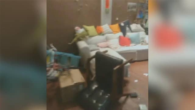 Resident surveys damage in hostel after Taiwan earthquake