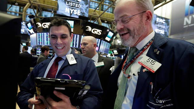 Wall Street erases Monday's losses with a late day rally