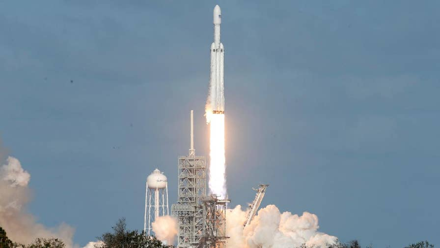 World's most-powerful rocket carries a Tesla car into space in test flight.