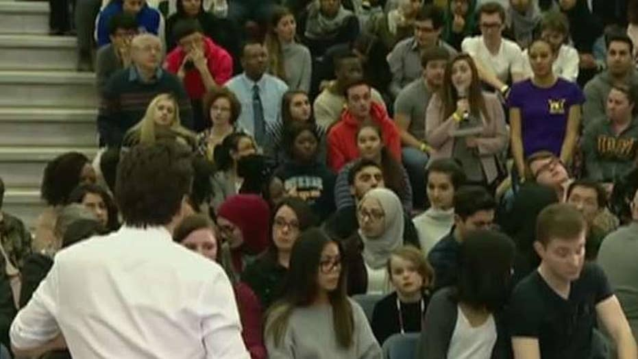 Trudeau corrects woman for using 'mankind' at town hall
