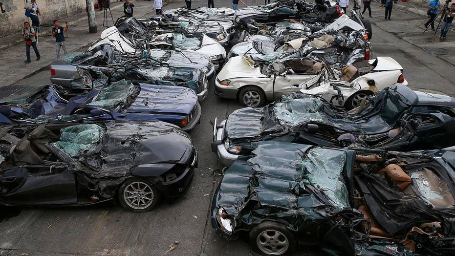 Duterte witnesses destruction of smuggled luxury cars