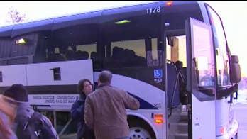Immigration activists decry citizenship checks on buses, trains