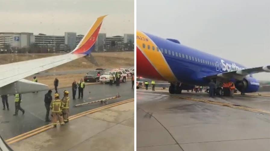 Raw video: Passenger records aftermath of incident where plane slid off taxiway at The Baltimore-Washington International Airport.