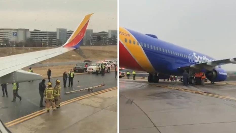 Southwest flight skids off icy runway in Maryland