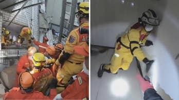 Raw video: Crews searching for survivors of massive earthquake forced to flee partially collapsed building in Hualien, Taiwan.