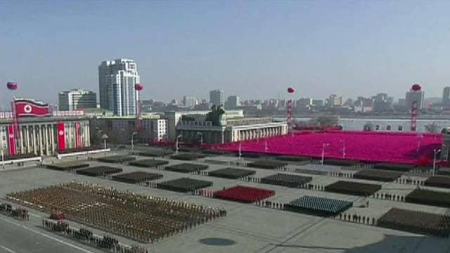 North Korea holds military parade as Olympics kick off