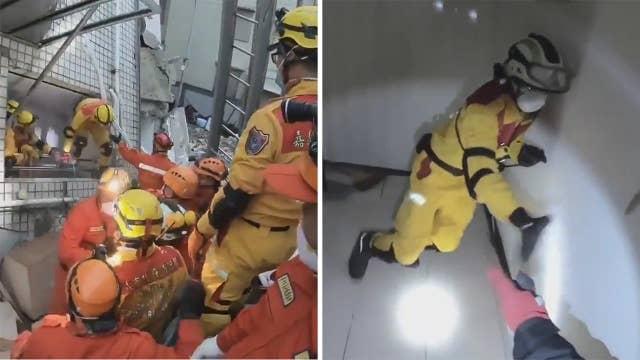 Rescuers evacuate leaning building as aftershocks hit Taiwan