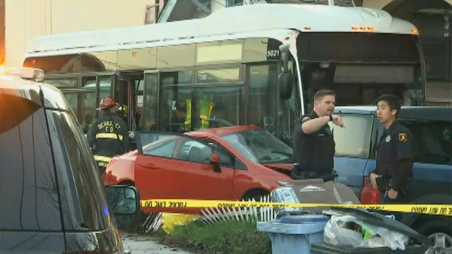 Raw video: Transit bus crashes into two Berkeley, California homes after accident with another vehicle.