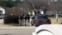 Law enforcement officials were attempting to serve a warrant; the suspect is dead.