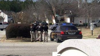 Law enforcement officials were attempting to serve a warrant; the suspect is dead.