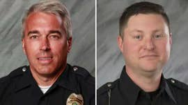 A man accused of fatally shooting two Ohio police officers responding to a 911 hang-up call has been indicted on charges that carry the possibility of a death sentence.