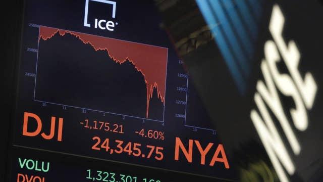 Pundits tie Dow drop to Trump