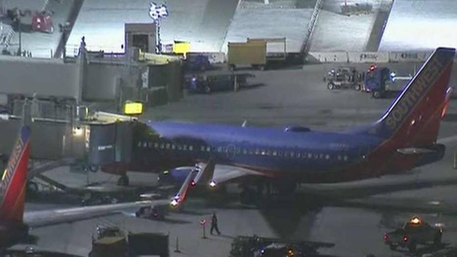 Shirtless man temporarily shuts down runway at LAX