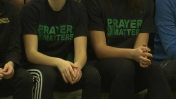 """Parents sported """"Prayer Matters"""" shirts in a silent protest against the ban"""