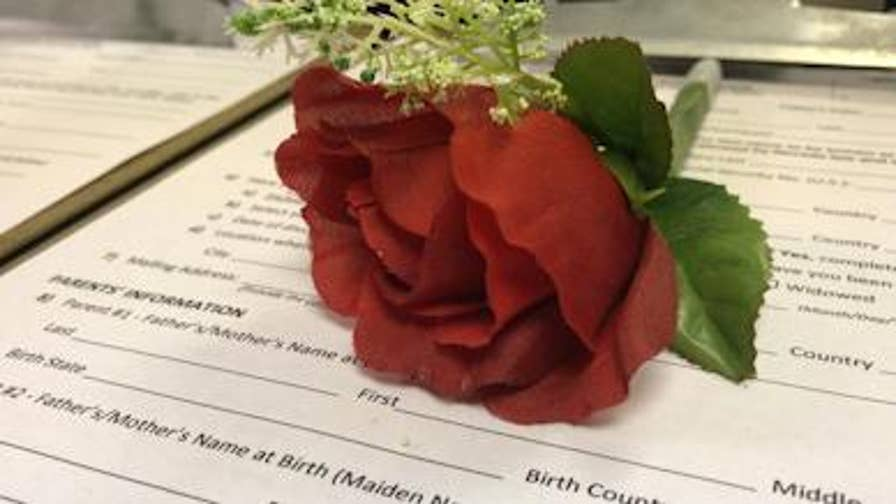 In time for Valentine's Day, Clark County sets up pop up marriage license bureau at Vegas airport.