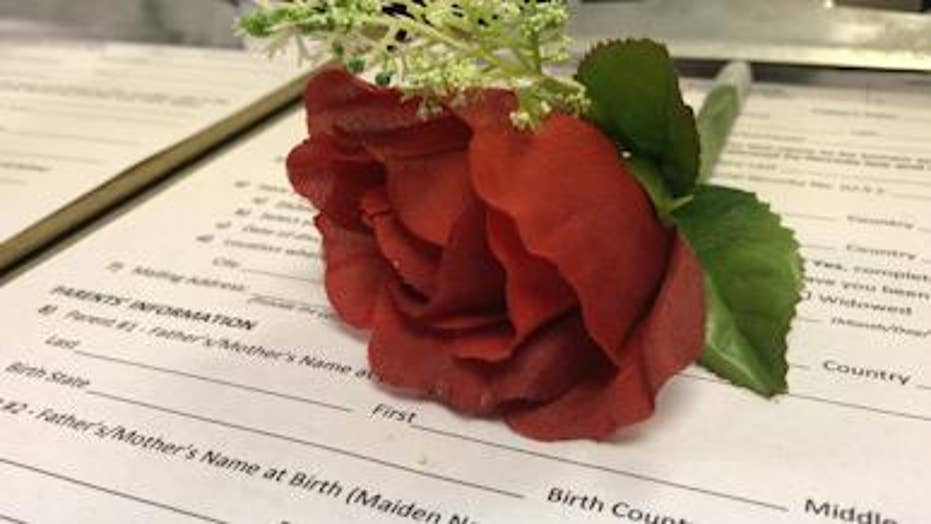 Couples obtain marriage licenses at Vegas airport